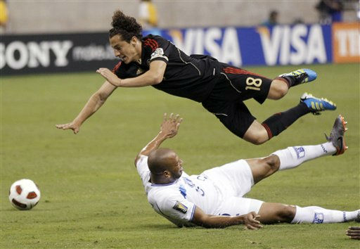 Mexico&#39;s Andres Guardado, top and Honduras&#39; Victor Bernardez take a tumble during the first half of a CONCACAF Gold Cup semifinal soccer match Wednesday, June 22, 2011, in Houston.  <span class=meta>(AP Photo&#47; David J. Phillip)</span>
