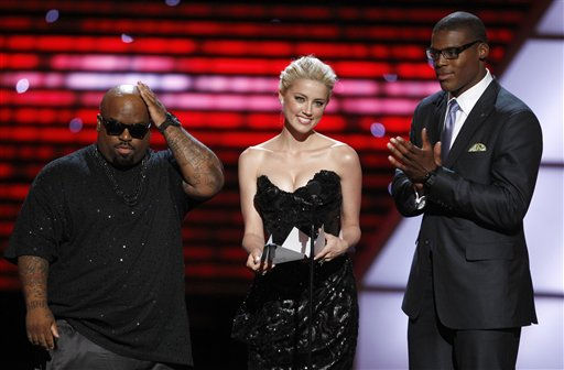 L to R, Cee Lo Green, Amber Heard and Cam Newton present the award for Best Play at the ESPY Awards on Wednesday, July 13, 2011, in Los Angeles. &#40;AP Photo&#47;Matt Sayles&#41; <span class=meta>(AP Photo&#47; Matt Sayles)</span>