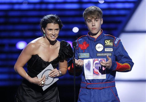 L to R, Danica Patrick and Justin Bieber present the award for Best Team at the ESPY Awards on Wednesday, July 13, 2011, in Los Angeles. &#40;AP Photo&#47;Matt Sayles&#41; <span class=meta>(AP Photo&#47; Matt Sayles)</span>