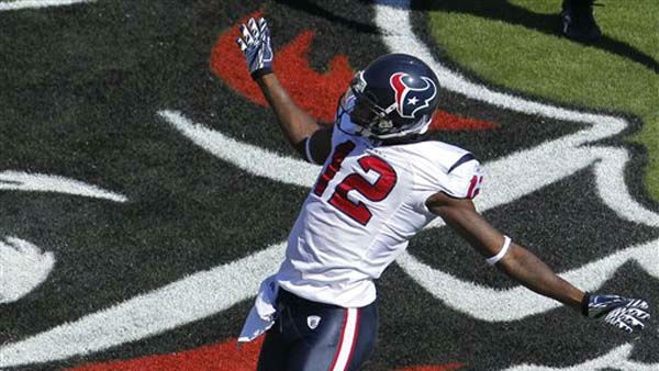 Houston Texans wide receiver Jacoby Jones &#40;12&#41; celebrates after scoring on a 80-yard touchdown reception from quarterback Matt Schaub during the first quarter of an NFL football game against the Tampa Bay Buccaneers, Sunday, Nov. 13, 2011, in Tampa, Fla. &#40;AP Photo&#47;Margaret Bowles&#41; <span class=meta>(AP Photo&#47; Margaret Bowles)</span>