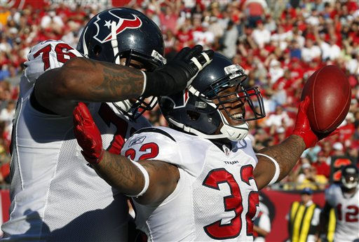 Houston Texans running back Derrick Ward &#40;32&#41; celebrates with teammate offensive tackle Duane Brown &#40;76&#41; after scoring a touchdown against the Tampa Bay Buccaneers during the third quarter of an NFL football game on Sunday, Nov. 13, 2011, in Tampa, Fla. &#40;AP Photo&#47;Chris O&#39;Meara&#41; <span class=meta>(AP Photo&#47; Chris O&#39;Meara)</span>