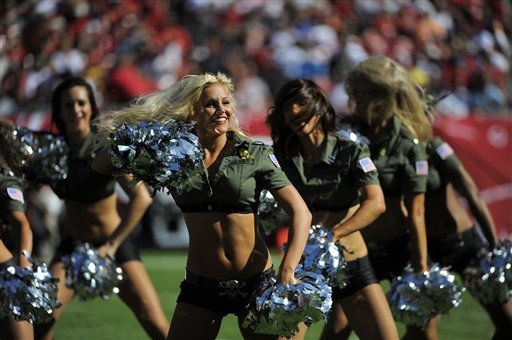 Tampa Bay Buccaneers&#39; cheerleaders entertain the crowd while wearing military-inspired uniforms during an NFL football game between the Tampa Bay Buccaneers and the Houston Texans Sunday, Oct. 16, 2011, in Tampa, Fla. &#40;AP Photo&#47;Brian Blanco&#41; <span class=meta>(AP Photo&#47; Brian Blanco)</span>