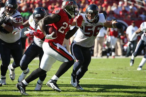 Tampa Bay Buccaneers running back LeGarrette Blount (27) tries to get past Houston Texans inside linebacker Brian Cushing (56). The Texans defeated the Buccaneers 37-9 in an NFL preseason game Sunday, November 13, 2011 in Tampa, Fla. (AP Photo/Margaret Bowles)