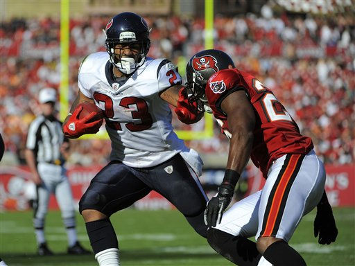 Houston Texans running back Arian Foster &#40;23&#41; fends off Tampa Bay Buccaneers strong safety Sean Jones &#40;26&#41; as he runs for several yards during an NFL football game Sunday, Oct. 16, 2011, in Tampa, Fla. &#40;AP Photo&#47;Brian Blanco&#41; <span class=meta>(AP Photo&#47; Brian Blanco)</span>