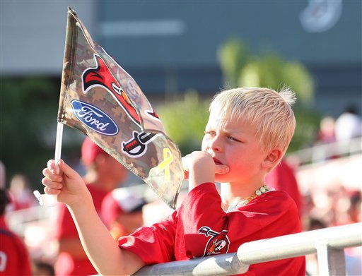 A young Tampa Bay Buccaneers fan watches in disappointment as the clock winds down in the game against the Houston Texans. The Texans defeated the Buccaneers 37-9 in an NFL preseason game Sunday, November 13, 2011 in Tampa, Fla. (AP Photo/Margaret Bowles)