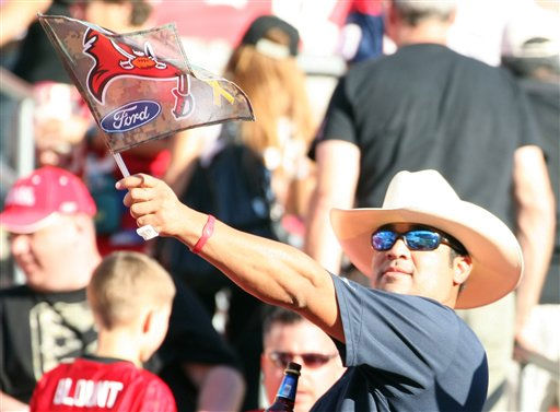 A Houston Texans fan celebrates a win over the Tampa Bay Buccaneers. The Texans defeated the Buccaneers 37-9 in an NFL preseason game Sunday, November 13, 2011 in Tampa, Fla. (AP Photo/Margaret Bowles)