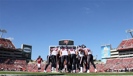 The Houston Texans huddle near the end zone in the game against the Tampa Bay Buccaneers. The Texans defeated the Buccaneers 37-9 in an NFL preseason game Sunday, November 13, 2011 in Tampa, Fla. (AP Photo/Margaret Bowles)