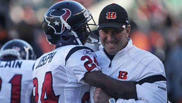 Houston Texans cornerback Johnathan Joseph &#40;24&#41; hugs Cincinnati Bengals special teams coach Darrin Simmons prior to an NFL football game, Sunday, Dec. 11, 2011, in Cincinnati. &#40;AP Photo&#47;Tony Tribble&#41; <span class=meta>(AP Photo&#47; Tony Tribble)</span>