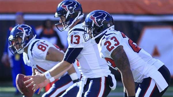 Houston Texans quarterback T.J. Yates &#40;13&#41; takes the snap in the first half of an NFL football game against the Cincinnati Bengals, Sunday, Dec. 11, 2011, in Cincinnati. Running back Arian Foster &#40;23&#41; stands at right. &#40;AP Photo&#47;Al Behrman&#41; <span class=meta>(AP Photo&#47; Al Behrman)</span>