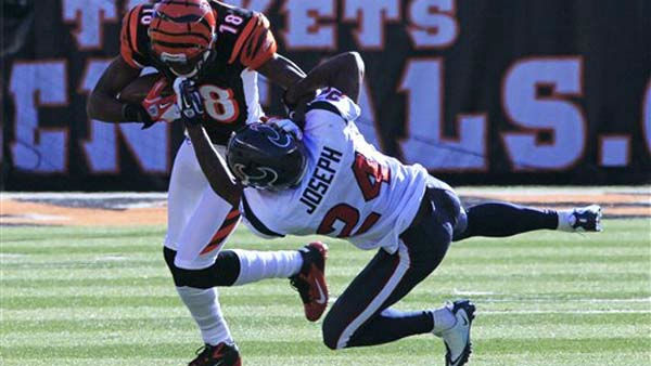 Cincinnati Bengals wide receiver A.J. Green &#40;18&#41; is tackled by Houston Texans cornerback Johnathan Joseph &#40;24&#41; after a short reception in the first half of an NFL football game, Sunday, Dec. 11, 2011, in Cincinnati. &#40;AP Photo&#47;Al Behrman&#41; <span class=meta>(AP Photo&#47; Al Behrman)</span>