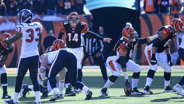 Cincinnati Bengals quarterback Andy Dalton &#40;14&#41; and center Kyle Cook &#40;64&#41; adjust a play against the Houston Texans in the first half of an NFL football game, Sunday, Dec. 11, 2011, in Cincinnati. &#40;AP Photo&#47;Al Behrman&#41; <span class=meta>(AP Photo&#47; Al Behrman)</span>