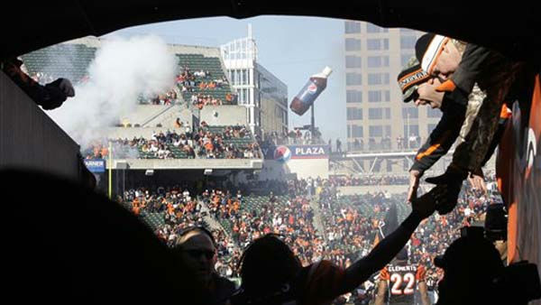 Cincinnati Bengals cornerback Adam Jones, center, clasps hands with fans at the start of an NFL football game against the Houston Texans, Sunday, Dec. 11, 2011, in Cincinnati. &#40;AP Photo&#47;Al Behrman&#41; <span class=meta>(AP Photo&#47; Al Behrman)</span>