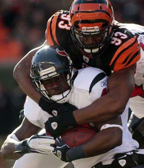 Cincinnati Bengals defensive end Michael Johnson &#40;93&#41; tackles Houston Texans running back Ben Tate after a short gain in the first half of an NFL football game on Sunday, Dec. 11, 2011, in Cincinnati. &#40;AP Photo&#47;Tony Tribble&#41; <span class=meta>(AP Photo&#47; Tony Tribble)</span>