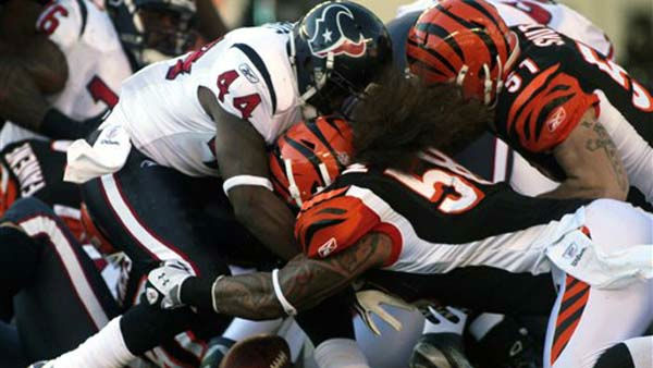 "<div class=""meta ""><span class=""caption-text "">Houston Texans running back Ben Tate (44) fumbles the ball as he is hit by Cincinnati Bengals linebackers Rey Maualuga (58) and Dan Skuta (51) in the first half of an NFL football game on Sunday, Dec. 11, 2011, in Cincinnati. Cincinnati recovered the fumble. (AP Photo/Tony Tribble) (AP Photo/ Tony Tribble)</span></div>"