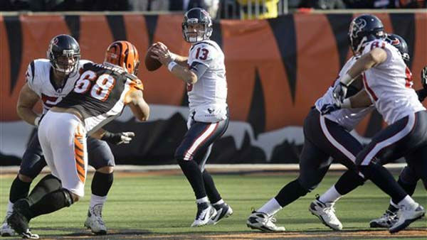 Houston Texans quarterback T.J. Yates &#40;13&#41; looks to pass against the Cincinnati Bengals in the first half of an NFL football game, Sunday, Dec. 11, 2011, in Cincinnati. &#40;AP Photo&#47;David Kohl&#41; <span class=meta>(AP Photo&#47; David Kohl)</span>