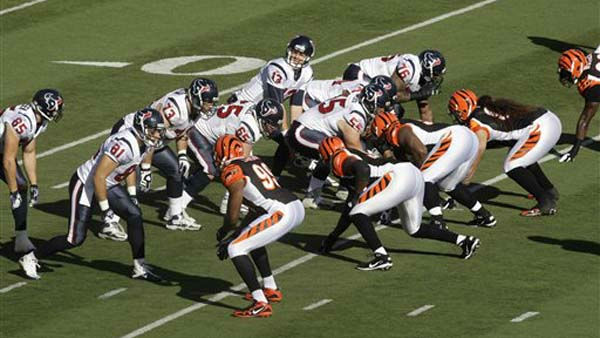 Houston Texans quarterback T.J. Yates &#40;13&#41; calls a play against the Cincinnati Bengals in the first half of an NFL football game, Sunday, Dec. 11, 2011, in Cincinnati. &#40;AP Photo&#47;David Kohl&#41; <span class=meta>(AP Photo&#47; David Kohl)</span>