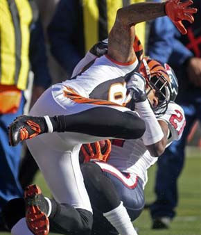 Cincinnati Bengals wide receiver Andre Caldwell &#40;87&#41; is tackled by Houston Texans cornerback Brice McCain &#40;21&#41; after catching a pass in the first half of an NFL football game on Sunday, Dec. 11, 2011, in Cincinnati. &#40;AP Photo&#47;Tony Tribble&#41; <span class=meta>(AP Photo&#47; Tony Tribble)</span>