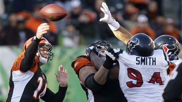 "<div class=""meta ""><span class=""caption-text "">Cincinnati Bengals quarterback Andy Dalton (14) passes against the Houston Texans in the first half of an NFL football game, Sunday, Dec. 11, 2011, in Cincinnati. (AP Photo/David Kohl) (AP Photo/ David Kohl)</span></div>"