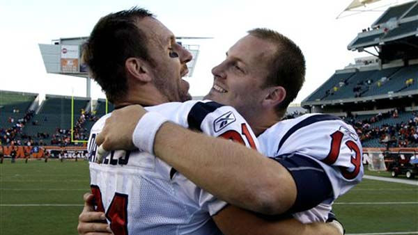 Houston Texans quarterback T.J. Yates &#40;13&#41; hugs tight end Owen Daniels after they defeated the Cincinnati Bengals 20-19 in an NFL football game on Sunday, Dec. 11, 2011, in Cincinnati. &#40;AP Photo&#47;David Kohl&#41; <span class=meta>(AP Photo&#47; David Kohl)</span>