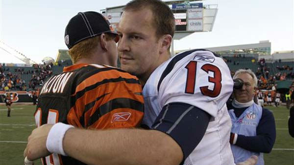 Houston Texans quarterback T.J. Yates &#40;13&#41; hugs Cincinnati Bengals quarterback Andy Dalton after Houston defeated the Bengals 20-19 in an NFL football game on Sunday, Dec. 11, 2011, in Cincinnati. &#40;AP Photo&#47;Al Behrman&#41; <span class=meta>(AP Photo&#47; Al Behrman)</span>
