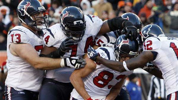 Houston Texans wide receiver Kevin Walter &#40;83&#41; is mobbed by teammates Eric Winston &#40;73&#41;, Wade Smith &#40;74&#41;, Chris Myers and Jacoby Jones &#40;12&#41; after catching a touchdown pass in the closing seconds of an NFL football game against the Cincinnati Bengals, Sunday, Dec. 11, 2011, in Cincinnati. Houston won 20-19. &#40;AP Photo&#47;David Kohl&#41; <span class=meta>(AP Photo&#47; David Kohl)</span>