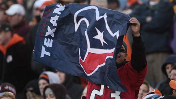 A Houston Texans fan celebrates during the second half of an NFL football game against the Cincinnati Bengals, Sunday, Dec. 11, 2011, in Cincinnati. &#40;AP Photo&#47;Tony Tribble&#41; <span class=meta>(AP Photo&#47; Tony Tribble)</span>