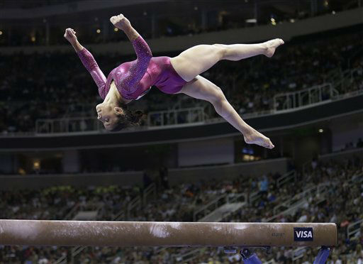 Aly Raisman performs on the balance beam during the preliminary round of the women&#39;s Olympic gymnastics trials, Friday, June 29, 2012, in San Jose, Calif. &#40;AP Photo&#47;Gregory Bull&#41; <span class=meta>(AP Photo&#47; Gregory Bull)</span>