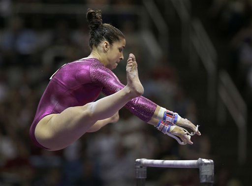 "<div class=""meta image-caption""><div class=""origin-logo origin-image ""><span></span></div><span class=""caption-text"">Aly Raisman reaches for the top bar on the uneven bars during the preliminary round of the women's Olympic gymnastics trials, Friday, June 29, 2012, in San Jose, Calif. (AP Photo/Jae C. Hong) (AP Photo/ Jae C. Hong)</span></div>"