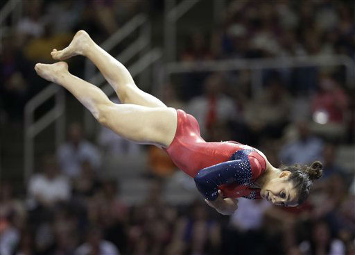 "<div class=""meta image-caption""><div class=""origin-logo origin-image ""><span></span></div><span class=""caption-text"">Aly Raisman competes in the floor exercise event during the final round of the women's Olympic gymnastics trials, Sunday, July 1, 2012, in San Jose, Calif. Raisman was named to the U.S. Olympic gymnastics team. (AP Photo/Jae C. Hong) (AP Photo/ Jae C. Hong)</span></div>"