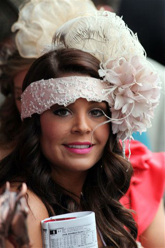 A racing fan with a fancy hat is seen before a race in the paddock at Churchill Downs Saturday, May 4, 2013, in Louisville, Ky. Today is the 139th running of the Kentucky Derby.   <span class=meta>(AP Photo&#47;Gregory Payan)</span>