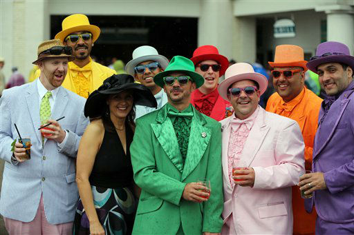 "<div class=""meta ""><span class=""caption-text "">A group of fans in colorful hats and suits are seen in the paddock before the third race of the day at Churchill Downs Saturday, May 4, 2013, in Louisville, Ky. Today is the 139th running of the Kentucky Derby.   (AP Photo/Gregory Payan)</span></div>"