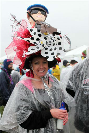 A racing fan with a fancy hat is seen on the infield at Churchill Downs Saturday, May 4, 2013, in Louisville, Ky. Today is the 139th running of the Kentucky Derby. (AP Photo/Gregory Payan)