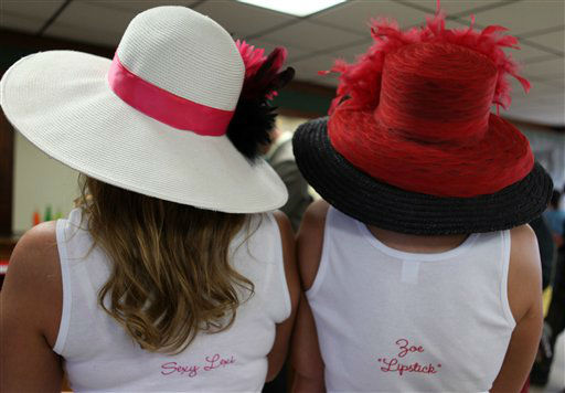 Racing fans with hats, &#39;Sexy Lexi&#39; and &#39;Zoe Lipstick&#39; are seen in the track kitchen on the morning of the Kentucky Derby at Churchill Downs Saturday, May 4, 2013, in Louisville, Ky. Today is the 139th running of the Kentucky Derby.   <span class=meta>(AP Photo&#47;Gregory Payan)</span>