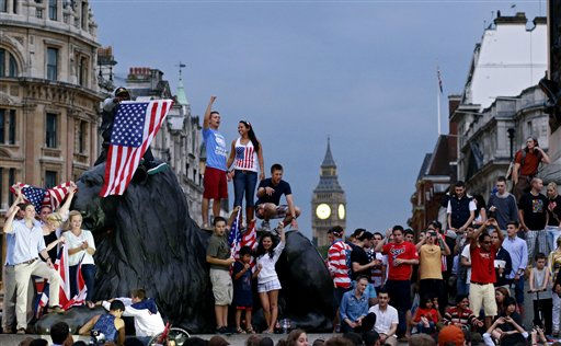 Spectators wave their national flags at Trafalgar Square in downtown London to watch a clock countdown prior to the Opening Ceremony the 2012 Summer Olympics, Friday, July 27, 2012, in London.  <span class=meta>(AP Photo&#47; Sergey Ponomarev)</span>