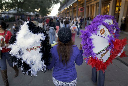 Diamond Miles, of New Orleans, walks through the French Quarter selling Super Bowl themed parasols which she and her cousin made for football fans, Saturday, Feb. 2, 2013, in New Orleans. The city will host NFL football&#39;s Super Bowl XLVII between the Baltimore Ravens and the San Francisco 49ers on Sunday. &#40;AP Photo&#47;Julie Jacobson&#41; <span class=meta>(AP Photo&#47; Julie Jacobson)</span>