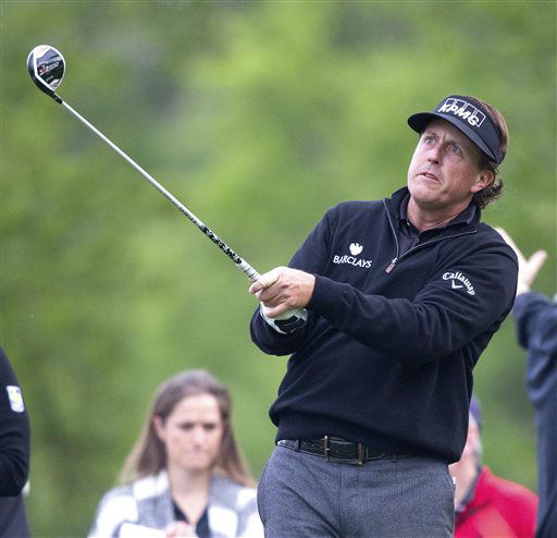 Phil Mickelson watches his tee shot during the first round of the Houston Open golf tournament, Thursday, March 28, 2013 in Humble, Texas.   <span class=meta>(AP Photo&#47; Bob Levey)</span>
