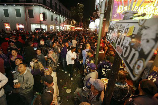 "<div class=""meta ""><span class=""caption-text "">Fans walk along Bourbon Street in the French Quarter Saturday, Feb. 2, 2013, in New Orleans. The Baltimore Ravens will face the San Francisco 49ers in NFL football's Super Bowl XLVII on Sunday.  (AP Photo/ Dave Martin)</span></div>"