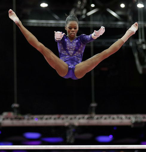 "<div class=""meta image-caption""><div class=""origin-logo origin-image ""><span></span></div><span class=""caption-text"">U.S. gymnast Gabrielle Douglas performs on the uneven bars during the Artistic Gymnastics women's qualification at the 2012 Summer Olympics, Sunday, July 29, 2012, in London. (AP Photo/Gregory Bull) (AP Photo/ Gregory Bull)</span></div>"