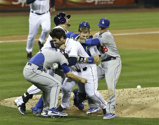 San Diego Padres&#39; Carlos Quentin, center without hat,  charges into Los Angeles Dodgers  pitcher Zack Greinke, left foreground, after being hit by a pitch in the sixth inning of baseball game in San Diego, Thursday, April 11, 2013.  <span class=meta>(AP Photo&#47; Lenny Ignelzi)</span>