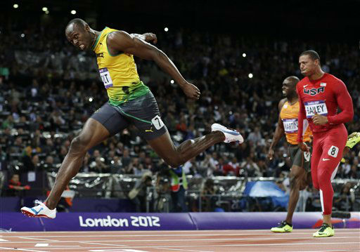 Jamaica&#39;s Usain Bolt crosses the finish line to win gold in the men&#39;s 100-meter final during the athletics in the Olympic Stadium at the 2012 Summer Olympics, London, Sunday, Aug. 5, 2012. &#40;AP Photo&#47;David J. Phillip &#41; <span class=meta>(AP Photo&#47; David J. Phillip)</span>