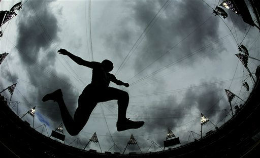 This picture taken with a fisheye lens shows France&#39;s Benjamin Compaore participating in the men&#39;s triple jump qualifying round during the athletics in the Olympic Stadium at the 2012 Summer Olympics, London, Tuesday, Aug. 7, 2012. &#40;AP Photo&#47;David J. Phillip&#41; <span class=meta>(AP Photo&#47; David J. Phillip)</span>