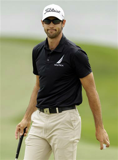 "<div class=""meta ""><span class=""caption-text "">Cameron Tringale acknowledges the crowd after making par on the 18th hole during the first round of the Houston Open golf tournament, Thursday, March 28, 2013, in Humble, Texas.  (AP Photo/ Bob Levey)</span></div>"