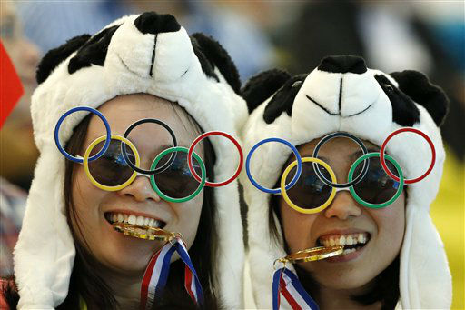 Two Chinese fans pause for photos prior to the Women&#39;s Synchronized 10 Meter Platform Diving final at the Aquatics Centre in the Olympic Park during the 2012 Summer Olympics, London, Tuesday, July 31, 2012. &#40;AP Photo&#47;Jae C. Hong&#41; <span class=meta>(AP Photo&#47; Jae C. Hong)</span>