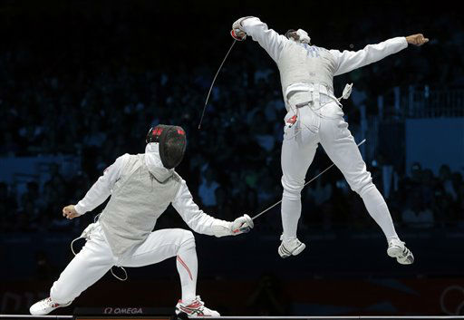 Ryo Miyake of Japan competes against  Andrea Baldini of Italy, right, compete in the gold medal match during the men&#39;s foil team fencing competition at the 2012 Summer Olympics, Sunday, Aug. 5, 2012, in London. &#40;AP Photo&#47;Dmitry Lovetsky&#41; <span class=meta>(AP Photo&#47; Dmitry Lovetsky)</span>