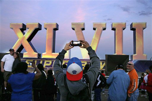 "<div class=""meta image-caption""><div class=""origin-logo origin-image ""><span></span></div><span class=""caption-text"">A football fan stops to take a picture of the Super Bowl XLVII sculpture on a barge along the Riverwalk , Saturday, Feb. 2, 2013, in New Orleans. The Baltimore Ravens play the San Francisco 49ers in NFL football's Super Bowl XLVII on Sunday.   (AP Photo/ Gene J. Puskar)</span></div>"