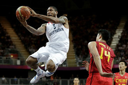 Great Britain&#39;s Drew Sullivan &#40;8&#41; sails to the basket past China&#39;s Wang Zhizhi &#40;14&#41; during a preliminary men&#39;s basketball game at the 2012 Summer Olympics, Monday, Aug. 6, 2012, in London. &#40;AP Photo&#47;Eric Gay&#41; <span class=meta>(AP Photo&#47; Eric Gay)</span>
