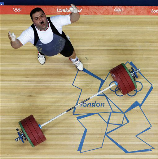Sajjad Anoushiravani Hamlabad of Iran reacts while competing during men&#39;s over 105-kg, group A, weightlifting competition at the 2012 Summer Olympics, Tuesday, Aug. 7, 2012, in London. Anoushiravani Hamlabad won the silver medal &#40;AP Photo&#47;Ng Han Guan&#41; <span class=meta>(AP Photo&#47; Ng Han Guan)</span>