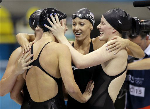 United States&#39; Shannon Vreeland, left, and Missy Franklin, right, embrace Allison Schmitt, foreground, and Dana Vollmer, center, after they won gold in the women&#39;s 4x200-meter freestyle relay swimming final at the Aquatics Centre in the Olympic Park during the 2012 Summer Olympics in London, Wednesday, Aug. 1, 2012. &#40;AP Photo&#47;Matt Slocum&#41; <span class=meta>(AP Photo&#47; Matt Slocum)</span>