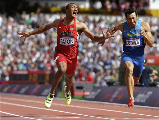 United States&#39; Ashton Eaton, left, and Ukraine&#39;s Voleksiy Kasyanov, right, cross the finish line in a men&#39;s decathlon 100-meter heat during the athletics in the Olympic Stadium at the 2012 Summer Olympics, London, Wednesday, Aug. 8, 2012. &#40;AP Photo&#47;Anja Niedringhaus&#41; <span class=meta>(AP Photo&#47; Anja Niedringhaus)</span>