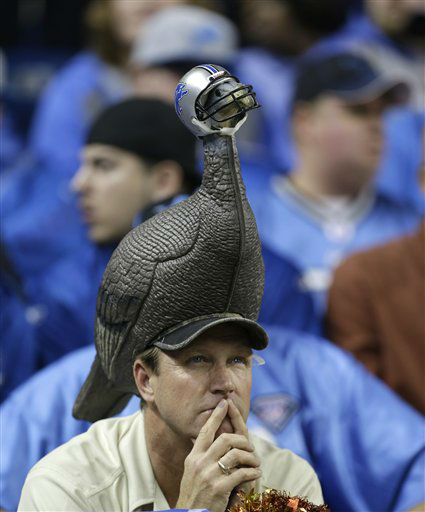 A Detroit Lions fan watches from the stands against the Houston Texans in overtime of an NFL football game in Detroit, Thursday, Nov. 22, 2012. Houston won 34-31.  <span class=meta>(AP Photo&#47; Paul Sancya)</span>